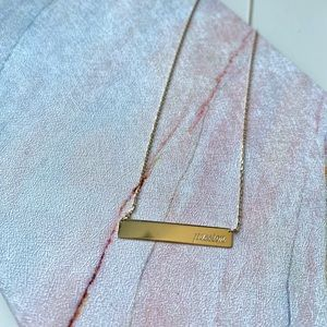 10K gold necklace engraved with word passion